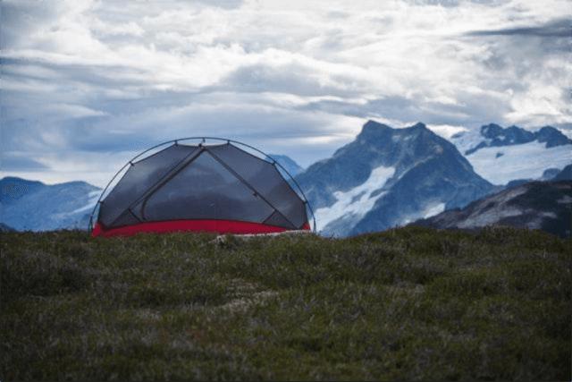 Tent_atop_mountain_landscape