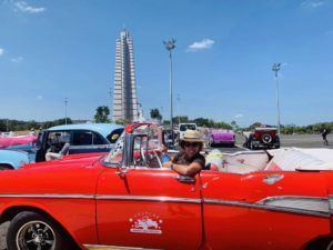 Author_Heidi_Siefkas_in_Classic_Chevy_Belair_in_Revolution_Square_Havana_Cuba