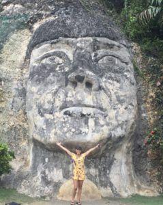 Author_Heidi_Siefkas_in_puerto_rico_with_Taino_chief_sculpture